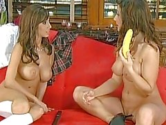 Beautiful Erica Campbell and Jaime Hammer sucking a big banana