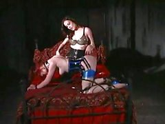 Redhead slave gets tied up by her mistress and gets pussy licked