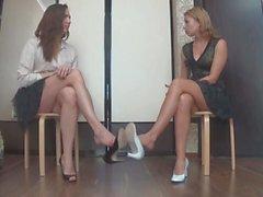 Two sexy russian girls show crossing legs