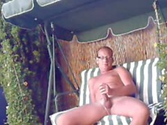 german male wanks in the garden outdoor 2
