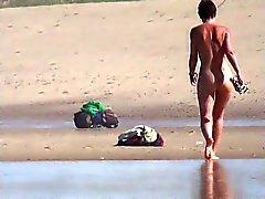 Girl with nice ass walking on European beach 4