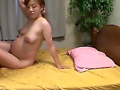 Pregnant asian hottie making out naked