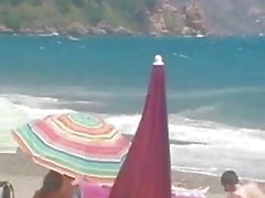 donna matura si masturba in spiaggia