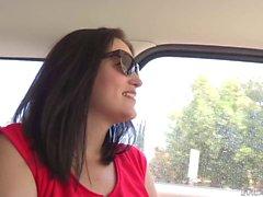 MILF brunette flashes her bush in the car