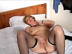 Lovely mature on a bed Larissa from 1fuckdatecom