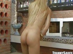 Sexy blonde shemale babe stripping