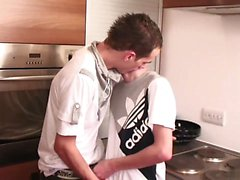 Slender gay guy gets his tool sucked by a boy in the kitchen