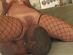 Busty brunette rides on black dick