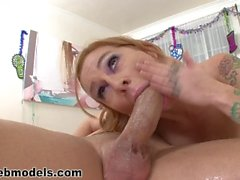 Fit redhead with big tits deepthroats a thick cock