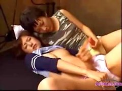 2 asian girls with fake cocks jerking one of them licked
