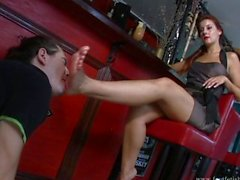 Goddess Victoria makes a slave suck her toes at the bar