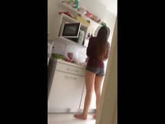 Young friend cooking in short pajamas