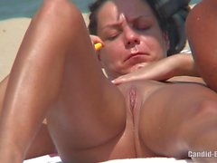 Shaved pussy nudist milfs tanning naked at the beach