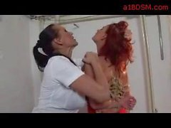 Redhead Girl Bondaged Arms Getting Her Body Rubbed Licked By Mistress On The Desk