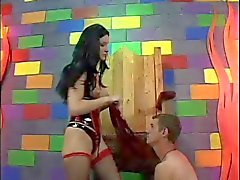 Dominatrix punishes her slave