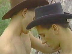 Cowboys molestan el uno al otro masturbarse
