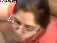 Indian wife blowing her husband