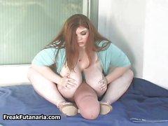 Super busty brunette rubbing her huge