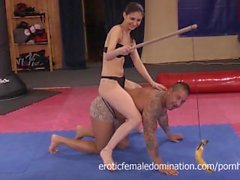 Brunette horse riding a guy in bikini, while baiting him with a banana