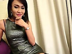 Thai ladyboy tgirl in stockings teasing with her tight body