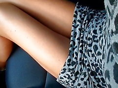 Panties under the dress in the car and legs without tights