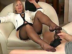 Mature with black pantyhose footjob