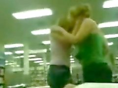Girls Kissing In the Library
