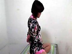 Kerroksissa gag koskevat sidottu kiinalaisen tytön