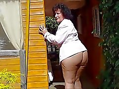 Mature German lady roaming around Bottomless in Backyard
