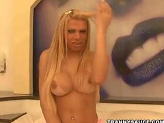 blonde tranny in braces strips and tugs her cock