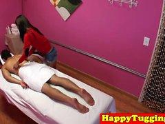Smalltitted asian masseuse wanking in massage