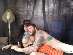 Tattooed Tgirl in handjob and blowjob action