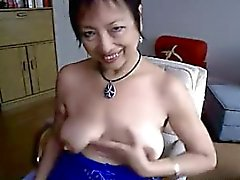 Asian granny Amy dildoing at home