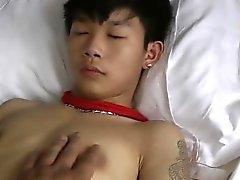 Netten asiatischen Boy Bound Handarbeit