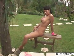 Shemale honey Paola Lima masturbating outdoors