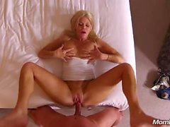Cougar Escort Deepthroating a Cock on Camera