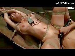 Bondaged Girl Getting Her Ass Fucked With Electric Strapon Pussy Stimulated With Vibrator By Mistress In The Dungeon