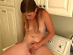 Lara Brookes on a washing machine