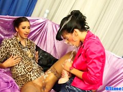 Glam lesbos straponfucking and covered in cum
