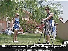 Gorgeous lovely blonde cheerleader training in the garden