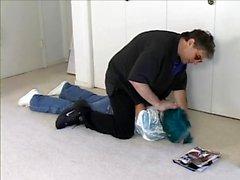 Blue shirt woman in basement