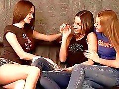 Three pretty teens having lesbian fun