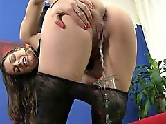 Naughty brunette in sexy dress pees during solo