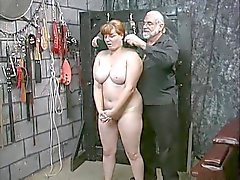 Cute young brunette slave girl strips naked for humiliation play in basement