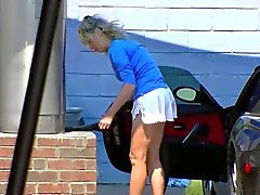 Blonde MILF shows cleavage and ass at the carwash