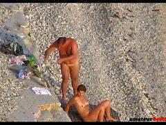 Kinky couple enjoying some naughty things on voyeur beach