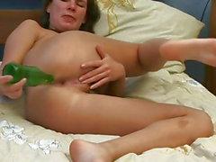 Wanton brunette bitch inserts green bottle in her tight ass hole