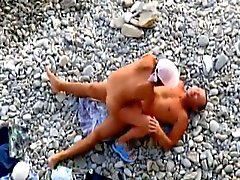 Couple fucked on beach in various positions