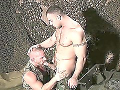 2 army men give each other intense blow jobs in the barracks