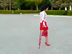 amputee girl wearing a single red heel
